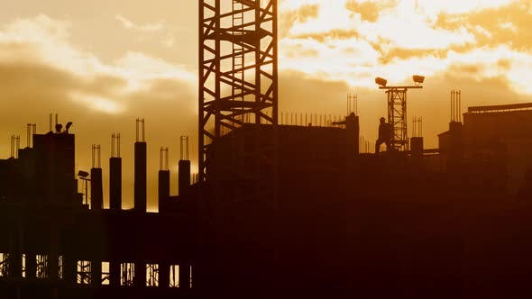 Thumbnail for Silhouette of Construction Workers and Tower Crane Working on Construction Site Sunny Evening