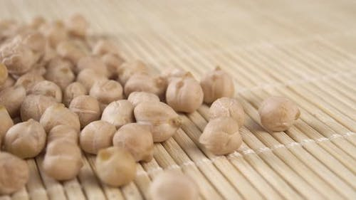 Chickpea grains on a bamboo mat