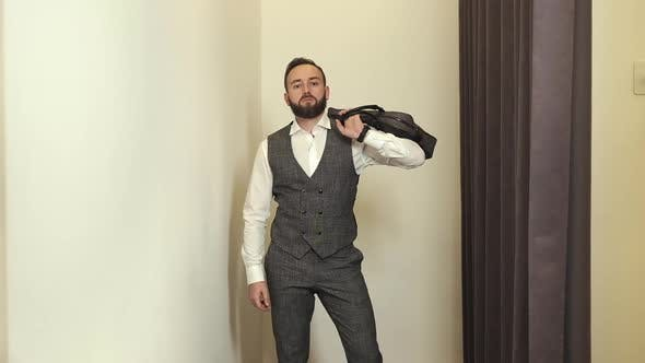 Thumbnail for Stylish Young Man In Clothing Store Posing In New Suit. He Funny Shows Combat Movements With Skill