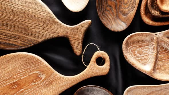 Thumbnail for Rich Variety of Wooden Empty Cutting Boards and Plates on Dark Background