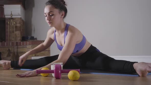 Thumbnail for Beautiful Brunette Woman Stretching on Matt. Confident Young Girl Sitting on the Twine. Healthy