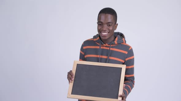Thumbnail for Young Happy African Man Holding Blackboard