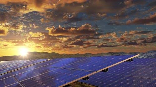 Alternative Energy By Solar Panels Against the Sunset Sky on the Electrical Farm
