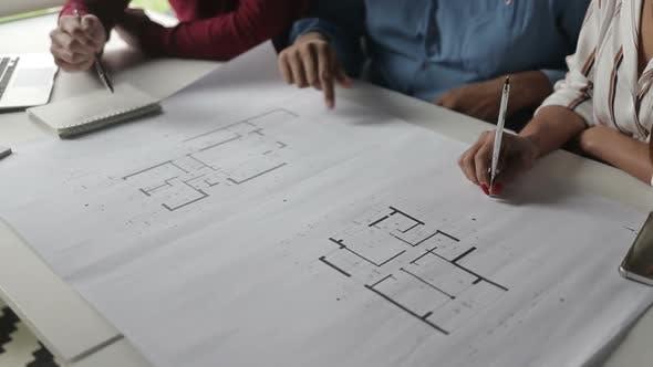 Cropped Shot of Architects Studying Blueprints