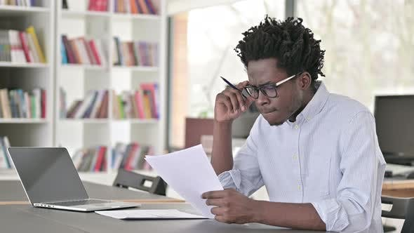 Cover Image for African Man Doing Paperwork