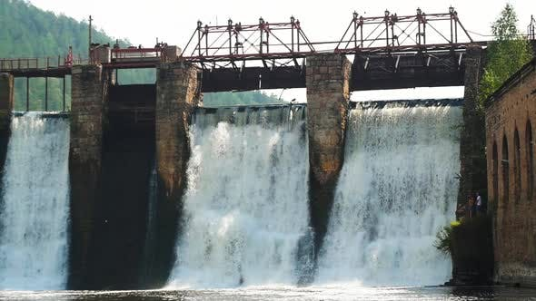 Thumbnail for Water Dam in the Forest - River Water Falls Down the Brick Wall