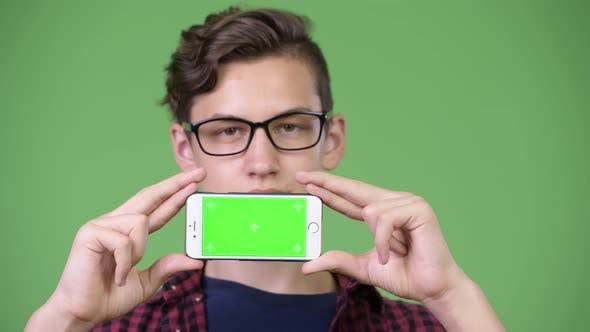 Thumbnail for Young Handsome Teenage Nerd Boy Showing Phone