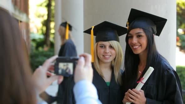 Graduates taking photos together