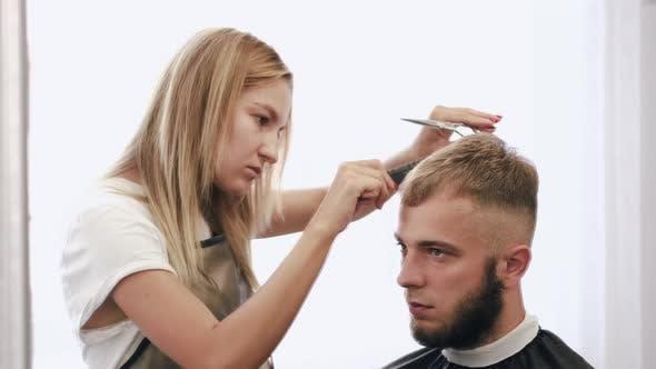 Thumbnail for Hairdresser Doing Haircut for Customer Using Scissors in Salon