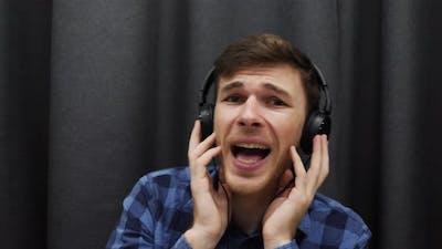 Man singing to the camera