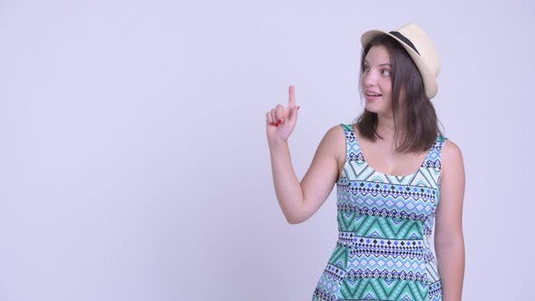 Thumbnail for Happy Young Beautiful Tourist Woman Thinking and Pointing Up