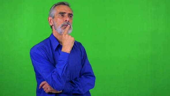 Thumbnail for Old Senior Man Walks and Thinks About Something - Green Screen - Studio