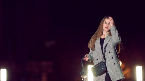Girl is Walking at Night in the Autumn City