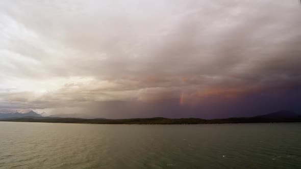 Thumbnail for Time lapse of rainbow in clouds over the ocean from cruise ship