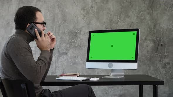Thumbnail for Male Designer Working At Computer In Contemporary Office