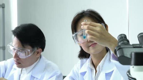 Asian women experiment of chemicals in the laboratory