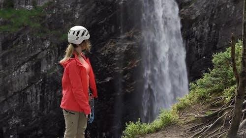 Rock Climber Watching Waterfall