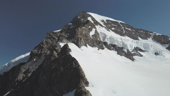 Thumbnail for Orbiting Shot of Swiss Mountain and Its Peak Covered in Snow