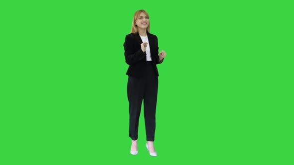 Thumbnail for Happy Businesswoman Using Virtual Digital Screen in Front of Her on a Green Screen, Chroma Key.