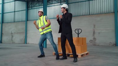 Funny Factory Workers Dance in the Factory