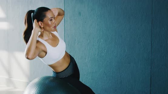 Thumbnail for Woman Exercising in the Gym