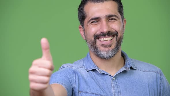 Handsome Persian Bearded Man Giving Thumbs Up