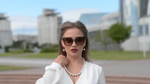 Elegant Girl in White Dress