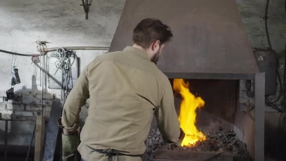 Thumbnail for Blacksmith Working in Workshop