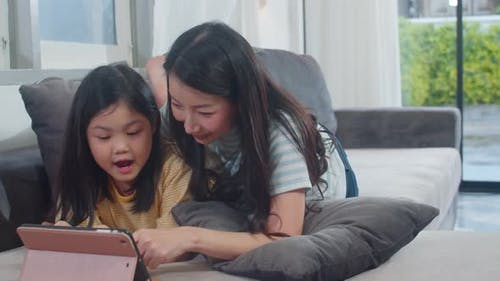 Lifestyle mother and kid happy fun spend time together in living room in modern home