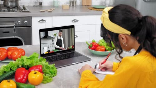 Smiling Woman in Kitchen Study Online Cooking Course Lesson Listen Chef Teacher
