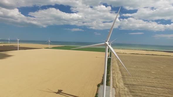 Thumbnail for Wind Vane on the Background of Yellow the Plantations Near the Sea. Aerial Survey