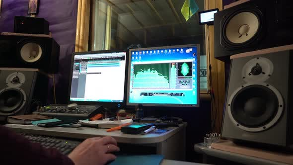 Thumbnail for Sound Engineer Working at Mixing Panel