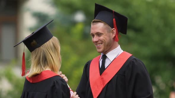 Thumbnail for Shy Man Talking to Female Friend at Graduation Ceremony, Achievement, Success