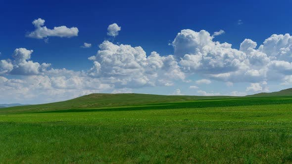 Thumbnail for Green Hill with Grass Under Cloudy Sky, Timelapse