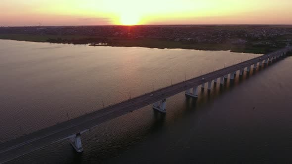 Thumbnail for Aerial Shot of a Far-off Bridge Over the Dnipro at Dreamy Sunset in Summer