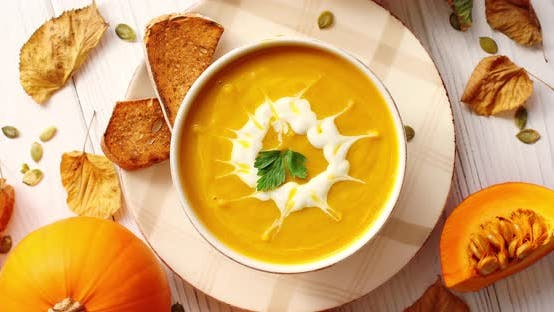 Thumbnail for Creamy Pumpkin Soup in Bowl with Herb