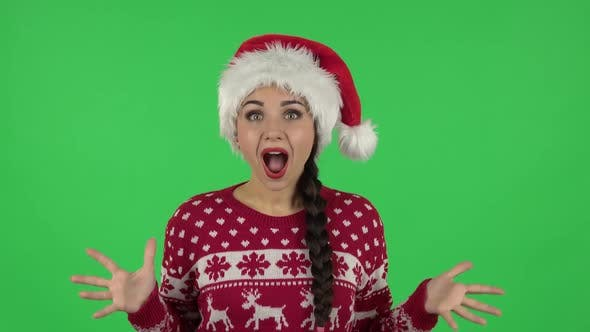 Thumbnail for Portrait of Sweety Girl in Santa Claus Hat with Shocked Surprised Wow Face Expression. Green Screen