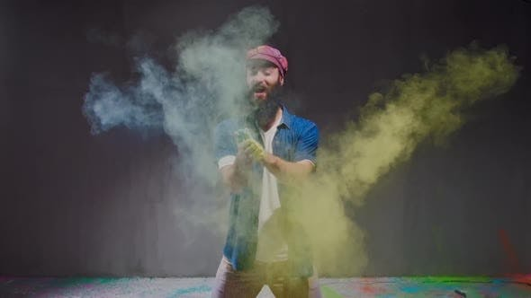 Thumbnail for Man Dancer Showing Break-dancing Moves Against Colourful Powder Explosion