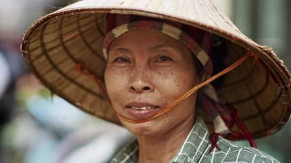 Thumbnail for Handheld video shows of Vietnamese senior woman. Shot with RED helium camera