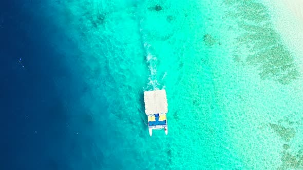Thumbnail for Natural overhead island view of a sandy white paradise beach and blue sea background in colourful 4K