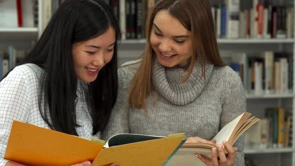 Thumbnail for Female Student Points Her Forefinger Into the Book at the Library