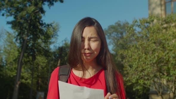 Thumbnail for Sad Desperate Asian Female Student Failed Exam