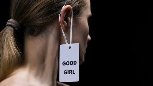 Strong Female Tearing Good Girl Label From Ear, Protesting Against Prejudice
