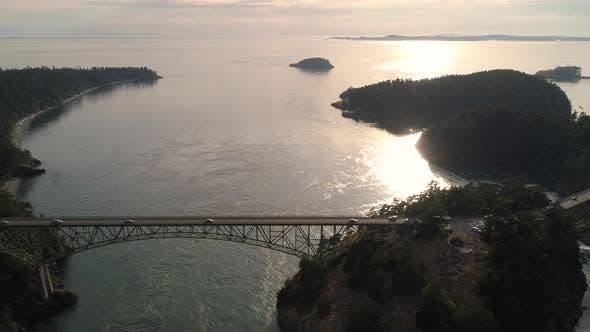 Thumbnail for Beautiful Pacific Northwest Road Trip Aerial Of Cars Driving Coastal Bridge By Ocean Islands