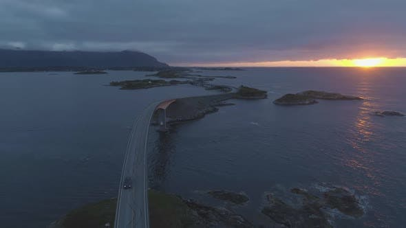 Thumbnail for Atlantic Ocean Road in Norway and Cars at Summer Sunset