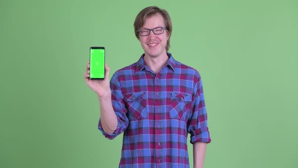 Thumbnail for Happy Young Handsome Hipster Man Showing Phone
