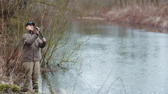 Thumbnail for Man Fishing At Lakeshore In Forest