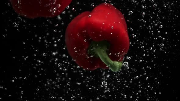Thumbnail for Ripe Bell Peppers Falling Into Water Black Background