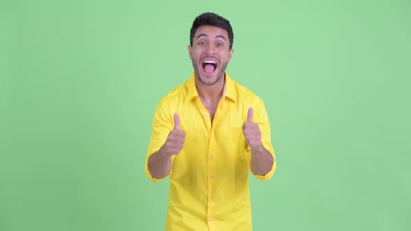 Thumbnail for Happy Young Hispanic Businessman Giving Thumbs Up and Looking Excited