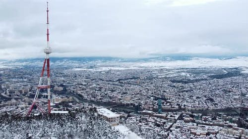 Snowy Transmit Mast Over The City